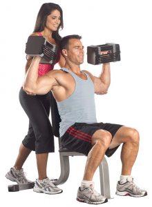 PowerBlock Elite adjustable dumbbells being used by couple