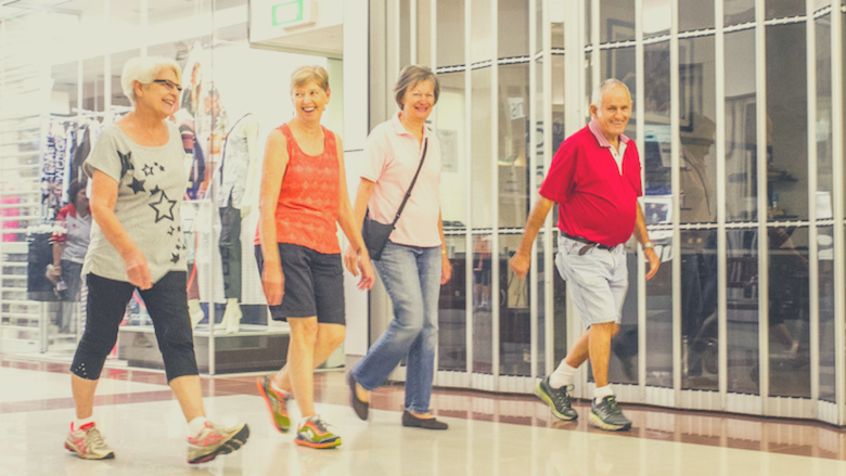 2 couples mall walking for fitness
