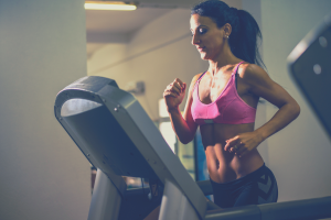girl on a treadmill with tv