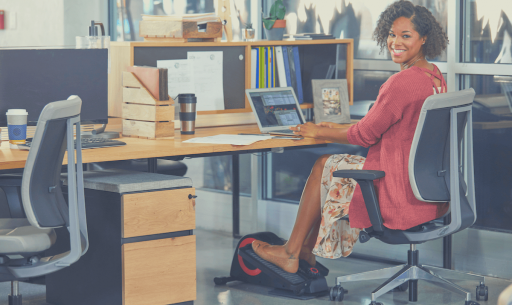 Woman at office with the best under desk elliptical