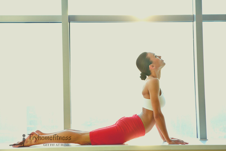 Benefits of stretching in the morning Women doing yoga pose