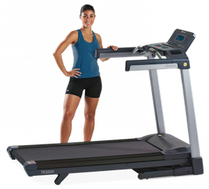 girl standing behind the Lifespan TR3000i treadmill