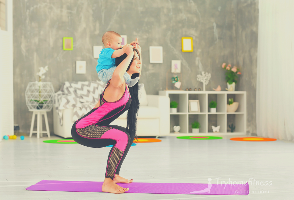 Mother doing squats with baby