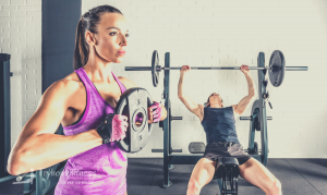 Couple using the best bumper plates