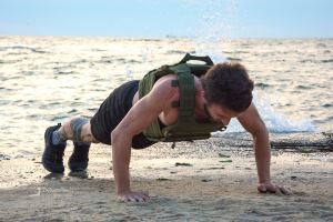 Man wearing weighted vest exercising