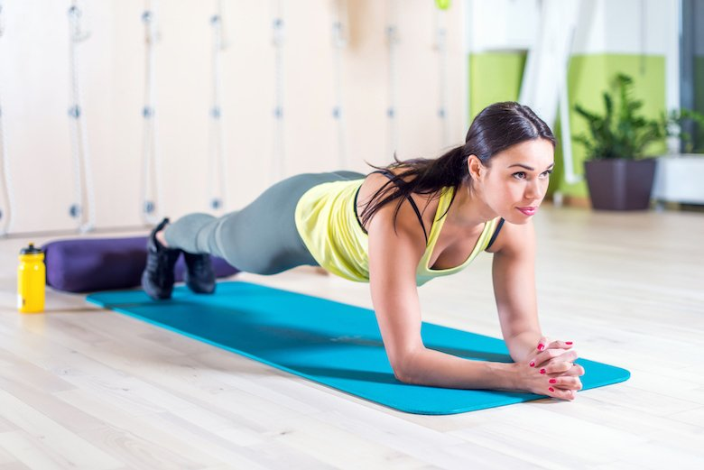 Girl doing a traditional plank at home