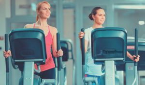 Mother & daughter on elliptical machines