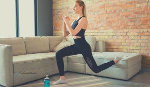 Girl indoors doing a lunge as a leg press alternative