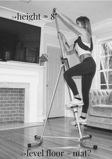 Grey image of woman on a vertical climber in her front room for MaxiClimber vs Versaclimber info.