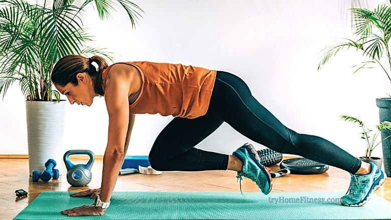 HIIT vs Cardio? This woman is doing mountain climbers indoors surrounded by other bits of equipment