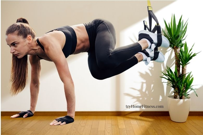 woman at home doing suspension training