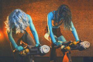 2 women on indoor bikes